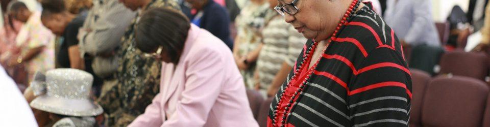 praying during church service